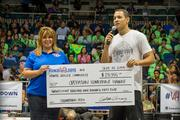 Hawaii VA Loans hosted its Third Annual Showdown, the state's largest CrossFit competition on Labor Day. Hawaii VA Loans and the Hawaii CrossFit Community donated $28,955 to Operation Homefront Hawaii, a nonprofit organization that provides emergency financial and other assistance to military families and Hawaii's Wounded Warriors. From left, Kellie Johnson, executive director for Operation Homefront Hawaii and Gabe Amey, president of Hawaii VA Loans and Showdown event organizer.