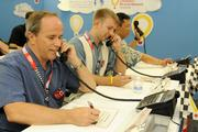 From left, Michael O'Malley, James Abraham and Jae Shin of Goodsill, Anderson Quinn & Stifel, answer phone calls during the Kapiolani Radiothon for Kids. The Children's Miracle Network and Kapiolani Medical Center raised a total of $151,088.