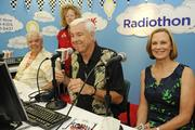 From left, Larry Price and Michael W. Perry with KSSK prepare to talk with Donna Miura, rear, and Martha Smith, CEO of Kapiolani Medical Center during the Kapiolani Radiothon for Kids. The Children's Miracle Network and Kapiolani Medical Center raised a total of $151,088.