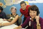 From left, Gidget Ruscetta, vice president of operations for Kapiolani Medical Center, Guy Kamitaki, Ace Hareware Store group leader, and Dawn Ching, vice president of operations for  Kapiolani Medical Center, answer phone calls during the Kapiolani Radiothon for Kids. The Children's Miracle Network and Kapiolani Medical Center raised $151,088.