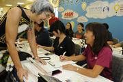 From left, Gidget Ruscetta, vice president of operations for Kapiolani Medical Center, and Kami Murashige, Ace Hardware volunteer, answers phone calls during the Kapiolani Radiothon for Kids. The Children's Miracle Network and Kapiolani Medical Center raised $151,088.