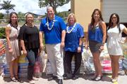 Oahu Society for the Prevention of Cruelty to Animals and Hawaiian Humane Society received 6,500 pounds of pet food and litter from PetSmart Mililani. From left are community relations specialists for the Hawaiian Humane Society Jamie Langlois and Maria Glidden, PetSmart Mililani Store Manager Kevin Rokosz, PetSmart Salon Manager Tammy Cox, President of Oahu SPCA Stephanie Ryan and Executive Director of the Oahu SPCA Abigail Lightning Bingham.