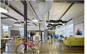Interior after: Blended work spaces  The 25,000 square feet of warehouse area, along with an existing 10,000-square-foot office pod, were replaced with playful, interactive work spaces that blur office and showroom areas, providing a collaborative environment.