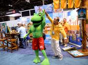 Yes, he's dancing with a giant bullfrog. I'm not here to judge.