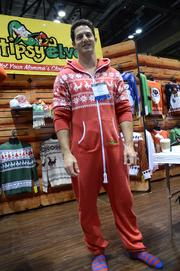 Evan Mendelsohn, founder of Tipsy Elves, models a one-piece sleeper. See ladies, I included a male model. You're welcome.