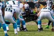 Seattle Seahawks defensive tackle Brandon Mebane waits for the opposing side to snap the ball.