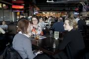 From left, Casey Kroger, Hilairy Begley and Jenna Kehrt, employees at the Museum Center, enjoy a lunch at the Yard House.