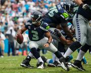 """Seattle's quarterback -- Russell Wilson is leading the Seahawks to the Super Bowl in just his second season as a pro. He has been named to the Pro Bowl roster twice and was NFL rookie of the year in 2012.  """"Wilson is one of those rare individuals who comes along once in a generation,"""" says ESPN's Terry Blount. """"He ... doesn't have the best arm in the league, but Wilson has all the intangible qualities you can't teach. He's a winner, a hard-working, high-character guy who makes everyone around him better. His teammates believe in him, and that's half the battle."""""""