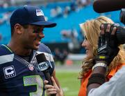 Seattle Seahawks quarterback Russell Wilson is interviewed after the game.
