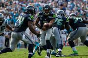 Seattle Seahawks quarterback Russell Wilson hands off to running back Marshawn Lynch.