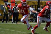 Chiefs quarterback Alex Smith hands off to Jamaal Charles in the first quarter.
