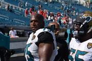 Jaguars linemen Eugene Monroe and Will Rackley leave the field after the game, a 28-2 shellacking at the hands of the Kansas City Chiefs in the 2013 season home opener.