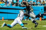 Carolina Panthers wide receiver Brandon LaFell can't haul in a pass after a collision with cornerback Walter Thurmond.