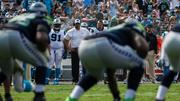 Carolina Panthers head coach Ron Rivera watches his defense struggle to stop the Seattle offense during a key stretch in the fourth quarter. The Panthers lost their 2013 home opener 12-7 to the Seahawks.