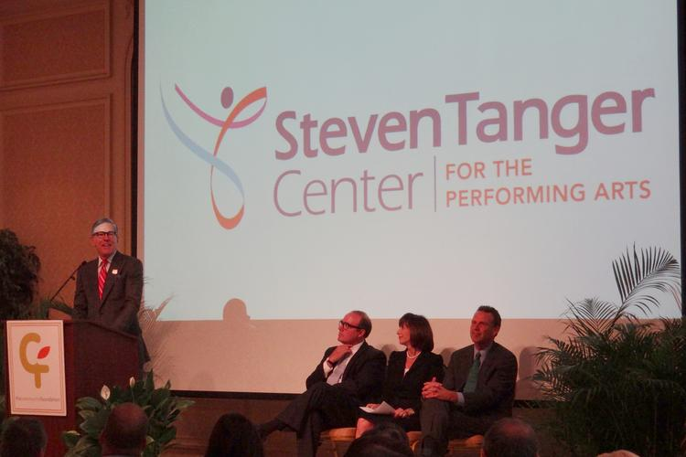 Steven Tanger, president and CEO of Tanger Factory Outlet Centers Inc., left, speaking after the announcement of a $7.5 million challenge gift for what will be the Steve Tanger Center for Performing Arts.