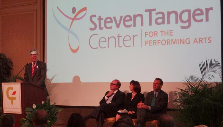 Steven Tanger, president and CEO of Tanger Factory Outlet Centers Inc., left, speaking at an announcement about the Steve Tanger Center for Performing Arts. The city of Greensboro will pay to help a nightclub move to make way for the center.