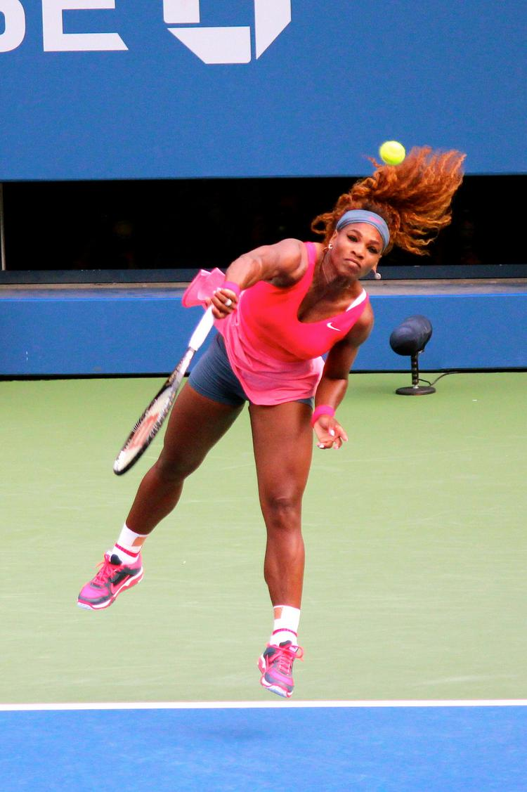 Serena Williams serves during the Women's Final of the 2013 US Open tennis tournament.