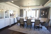 The dining room of M/I Homes' Avalon has built-in cabinets.