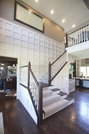 The open staircase leads to an overhead view of the living room at M/I Homes' Avalon.