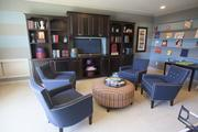 The game room in M/I Homes' Avalon features a ping pong table and an entertainment center.
