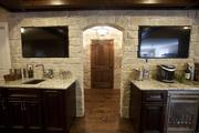 A wet bar, built-in refrigerator and wine room are part of the renovated basement from Justin Doyle Homes.