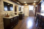 The finished basement shows off the remodeling part of Justin Doyle's business.