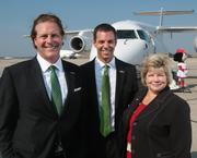 Ultimate Air Shuttle managing director Rick Pawlak, left, and Regional Manager Ryan Minton, center, join CVG CEO Candace McGraw.