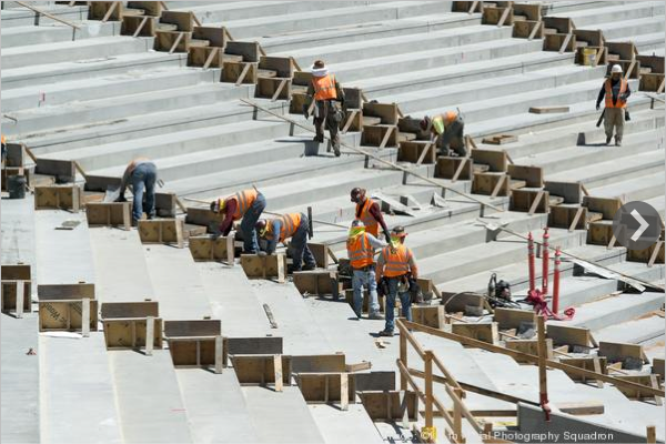 Construction crews at Levi's Stadium work to install seating at the venue. The project has passed the two-thirds completion mark ahead of an anticipated opening July 31, 2014.