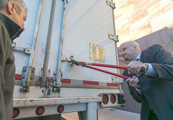 Maryland Live! Casino President Robert Norton, right, and Vice President of Table Games Neal Sloane open up the first truck full of blackjack tables at the casino on Wednesday morning.