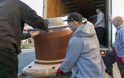 Crews unload the first truck full of blackjack tables at the Maryland Live casino on Wednesday morning.