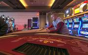 Maryland Live casino Pit Manager Paul Sheppard pulls the paper off a blackjack table delivered to the casino on Wednesday morning.