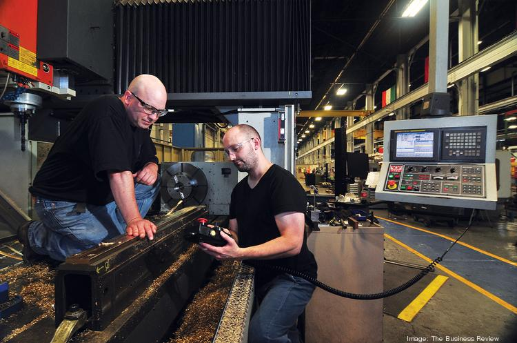 A supplier for the rail industry, Simmons Machine Tool makes sophisticated products that require highly skilled workers. The Menands company works with Hudson Valley Community College to find those workers. Here, Dwight Collin, a machinist intern from the college, left, works with mentor/machinist Kiam Kuczynski.