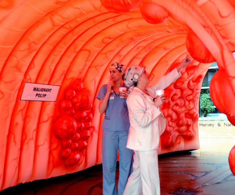 Staffers at MD Anderson pass through the giant colon. Yes, you read that right.
