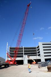 Work crews also make progress at the site of the I-Drive Live parking garage.