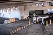 Workers inside the lower floors of the parking garage