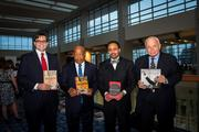 """The Kingonomics Conference came to the Walter E. Washington Convention Center on Aug. 23, featuring more than 100 speakers and programs focused on innovation, entrepreneurship and investment. From left, Andrew Aydin, co-author of """"MARCH (Book One)""""; Congressman John Lewis, co-author of """"MARCH (Book One)""""; Dr. Rodney Sampson, chairman, Kingonomics & Legacy Opportunity Fund and author of """"Kingonomics: Twelve Innovative Currencies for Transforming Your Business & Life""""; and Bob Adelman, Iconic Photo-documentarien and author of """"I Have A Dream: A 50th Year Testament To The March That Changed America."""""""
