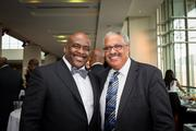 C. Earl Peek, founder and managing partner of Diamond Ventures, left, with an event guest.
