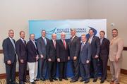 Former Oklahoma Gov. Frank Keating, center, with banking and business leaders.