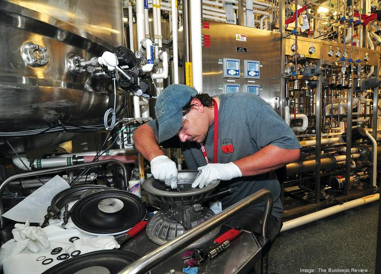 John Pavlick, a service technician, works on a pump at the Regeneron Pharmaceuticals Inc. lab in East Greenbush.