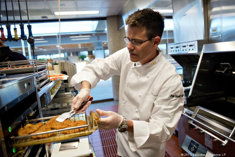 Dan Coudreaut, executive chef and director of culinary innovation for McDonald's Corp., prepares a McWrap in a test kitchen at McDonald's headquarters in Oak Brook, Ill. in July 2013.