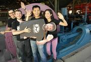 From left, TINYhr manager of customer happiness B.J. Shannon; lead developer Zach Hale; CEO and founder David Niu; lead developer Becker IV (in life-size photo cutout brought by the team); and director of customer happiness Alice Niu.