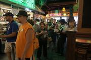 Customers line up for Portillo's offerings like hamburgers, shakes and salads.