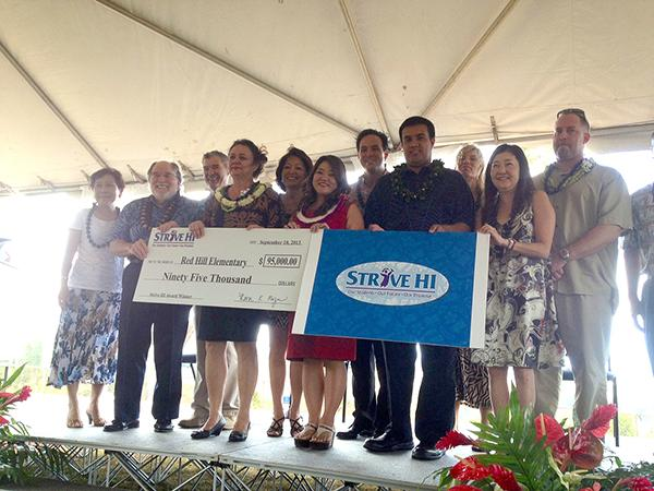 Teachers and administrators from Red Hill Elementary School received a check for $95,000 Tuesday during a ceremony at their school at which the state Department of Education awarded a total of $1 million to Hawaii's top performing public schools.