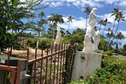 Statues litter a Kahala Avenue property formerly owned by Japanese billionaire Genshiro Kawamoto, who sold all 27 of his Kahala properties to Alexander & Baldwin Inc. for $98 million.