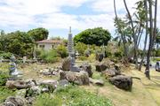 A property formerly owned by Genshiro Kawamoto that had turned into a storage yard for statues meant for a planned Japanese tea garden is seen from Kahala Avenue. The Japanese billionaire  sold all 27 of his Kahala properties to Alexander & Baldwin Inc. for $98 million.