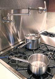 Crocenzi made sure the remodeled kitchen had an elegant pot filler over the commercial-grade kitchen stove.