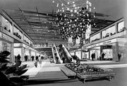 """An artist's painting of the interior of the Mayfield Mall, circa 1966, with an amazing chandelier front and center. """"The repurposing of the former Mayfield Mall will incorporate the property's historic architectural elements and will utilize green building techniques, modern design, and advanced building technology,"""" said Jason Oberman, a vice president with Rockwood Capital, in a statement. OK, enough of the historical stuff. Let's see Mayfield -- ahem -- San Antonio Station today."""