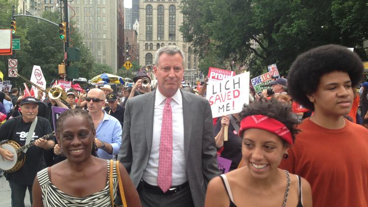 Bill de Blasio (center-left), with his wife, Chirlane McCray (right), and children, Chiara and Dante (right) march during a protest to save Long Island College Hospital.
