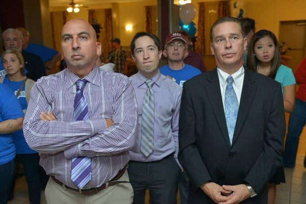 John J. Juliano Jr, Tim Kwiatkowski and Greg Chiecko of the Eastern States Exposition watch the casino results at the Dante Club.