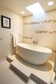 The couple's remodeled master suite features his-and-her dressing areas and a large soaking tub in the master bath.